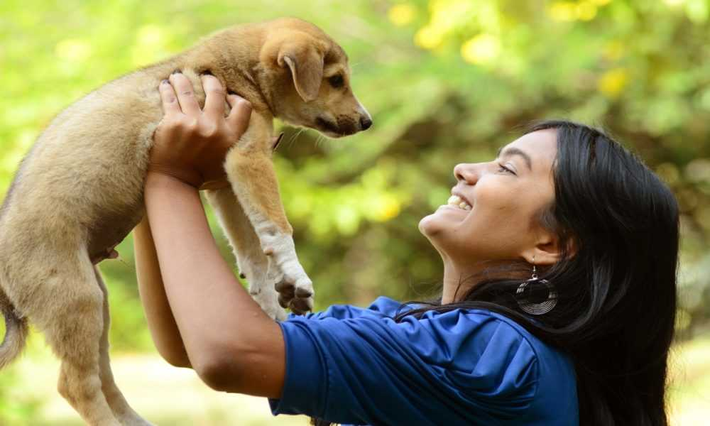 A person holding an animal